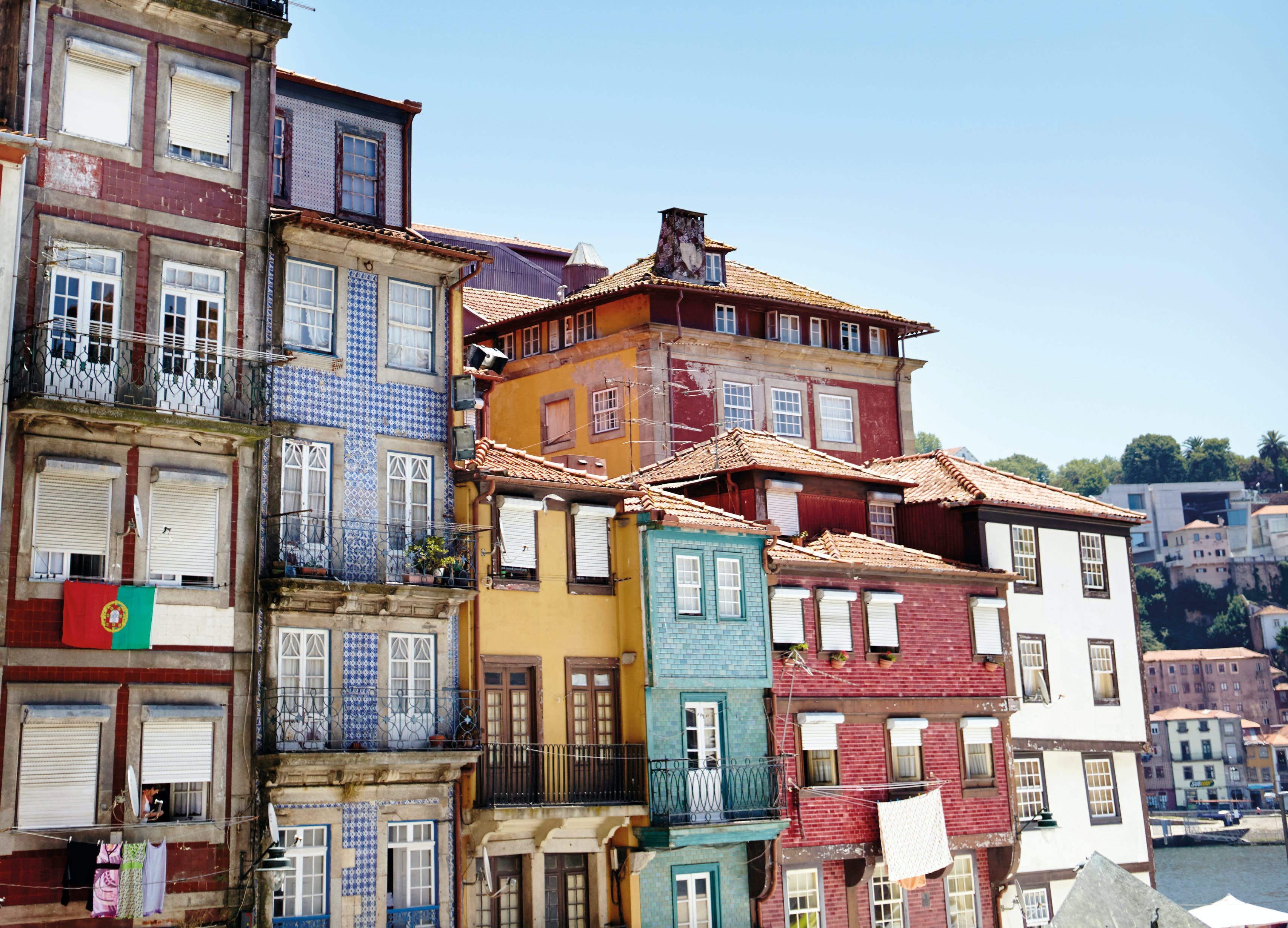 Houses with traditional tiled facades line the riverfront of Porto © Matt Munro / Lonely Planet