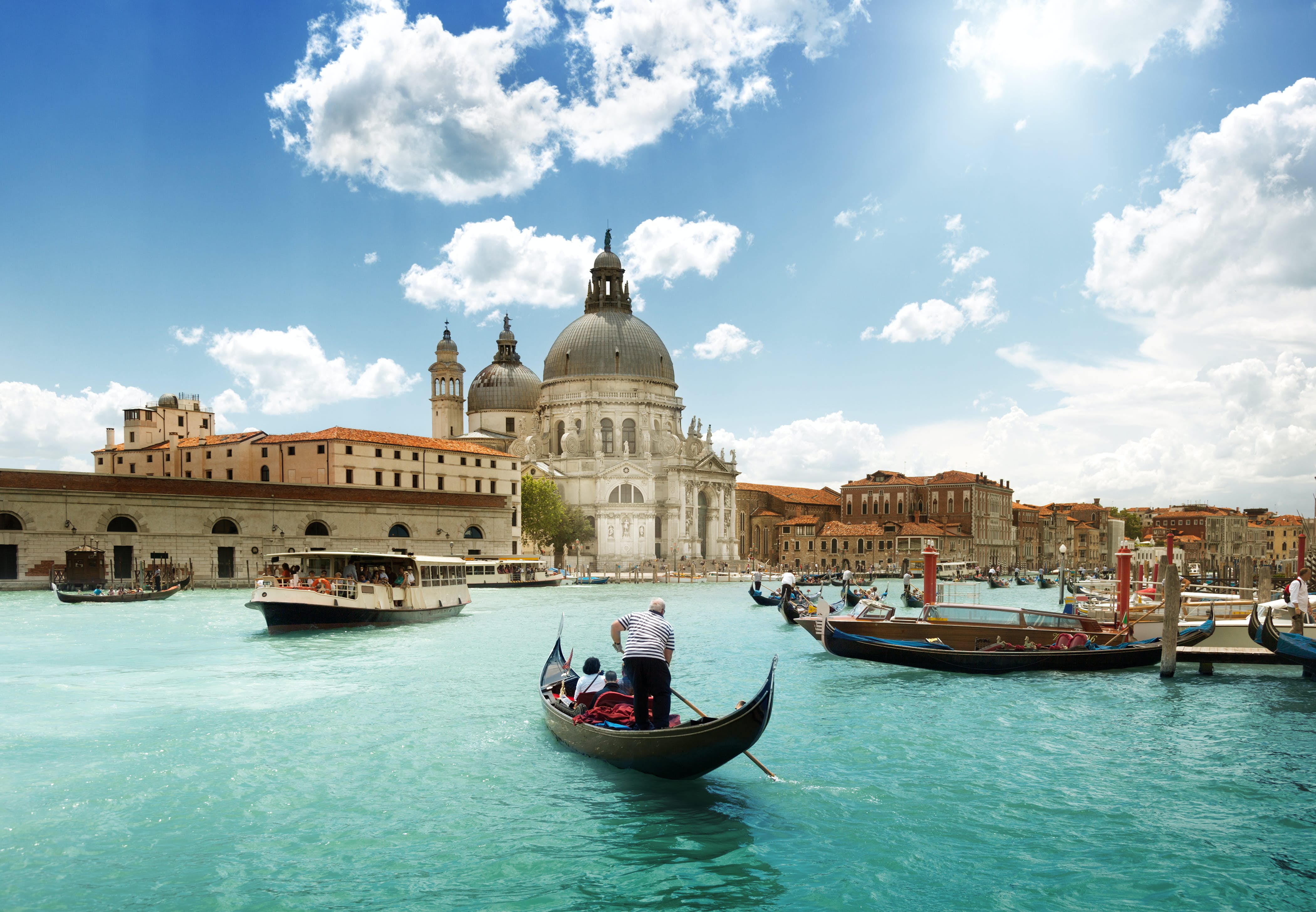 A gondola on Venice's Grand Canal steers toward the 17th-century Basilica di Santa Maria della Salute © Iakov Kalinin / Shutterstock