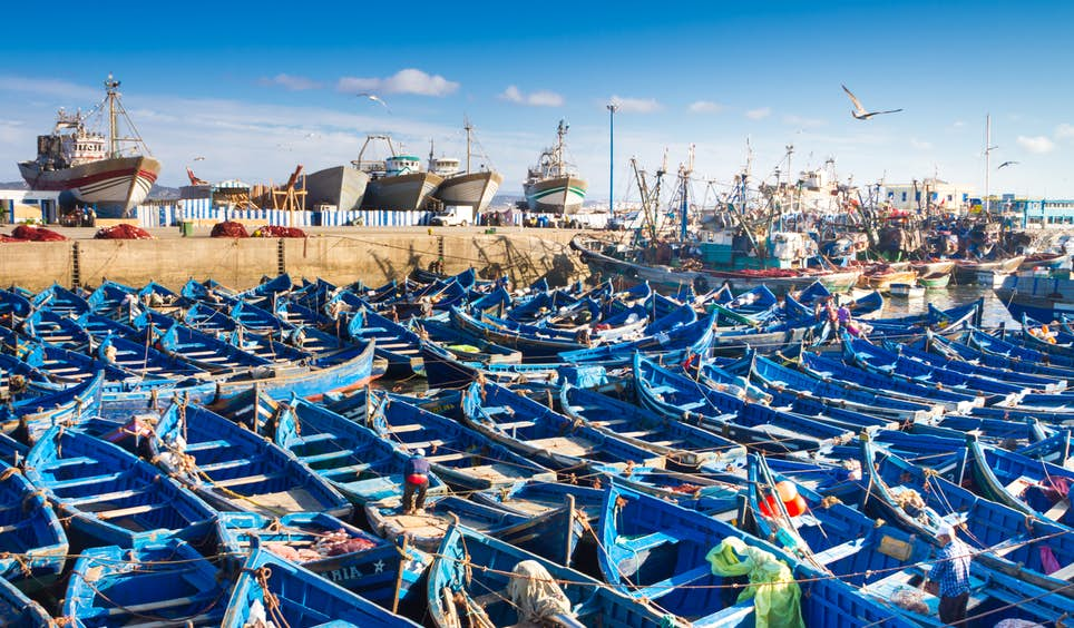A shipyard full of blue fishing boats in Essaouira © Matej Kastelic / 500px