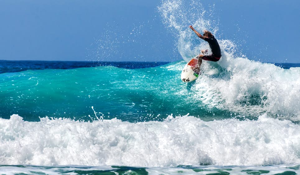 A surfer catching waves in laid-back Baja California © Javier Garcia / Shutterstock