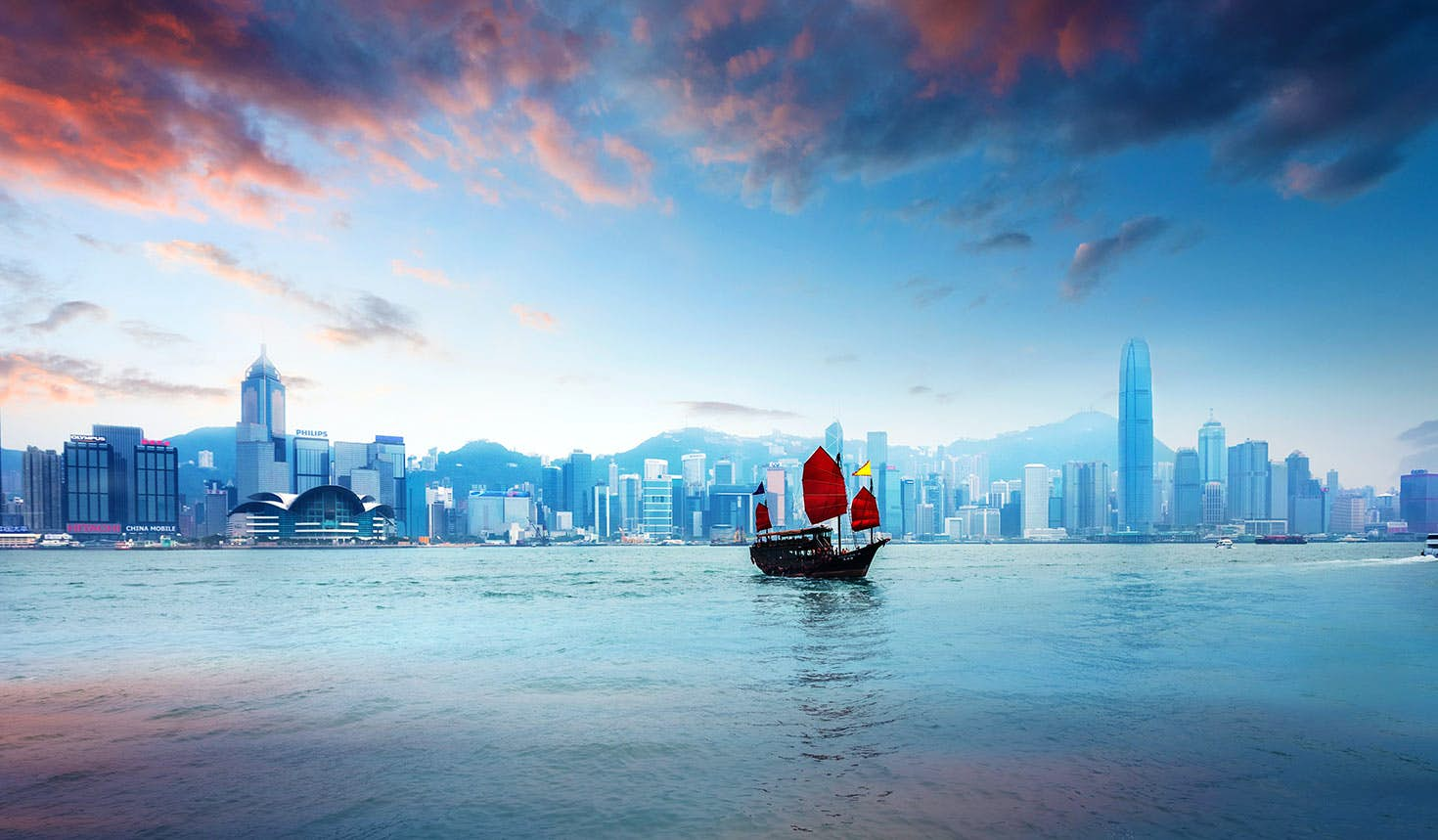 A traditional Chinese junk sailing across Victoria Harbour, Hong Kong Image: chinaface / Getty Images
