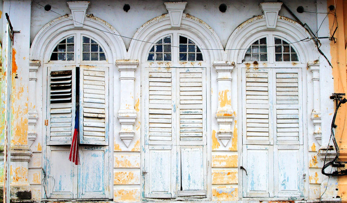 Window shutters in the charming old town disctrict of Ipoh, Malaysia. Image: coleong / Getty Images